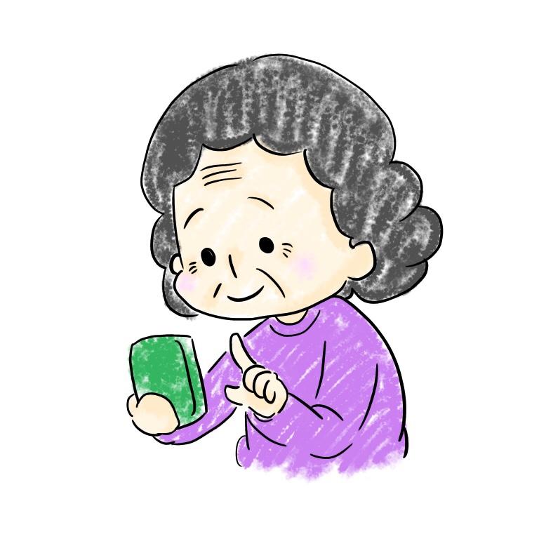 おばあちゃんがスマホを操作している めぐみ